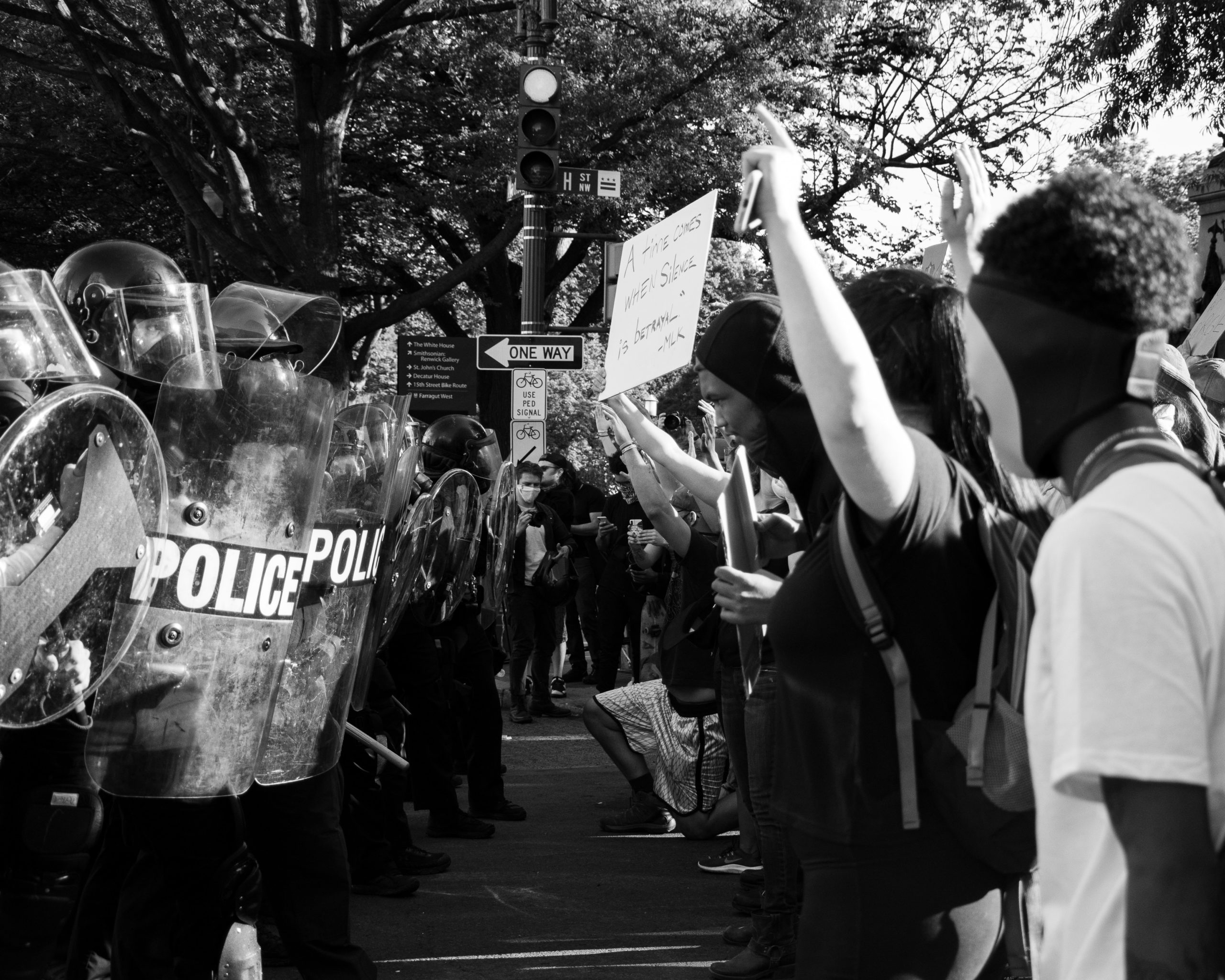 A group o Police men facing a group of protesters